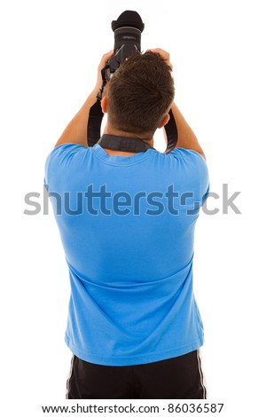 Young photographer with camera from the back, isolated on white - stock photo