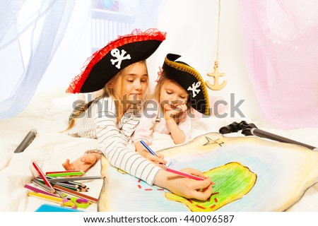 Young pirates drawing the treasure map - stock photo