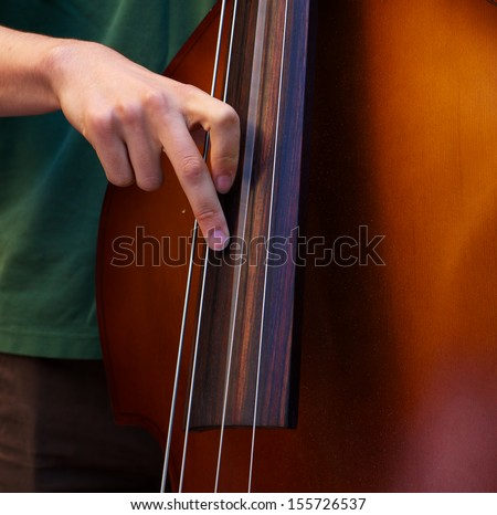 Young player playing the Bass with a  blue grass band - stock photo