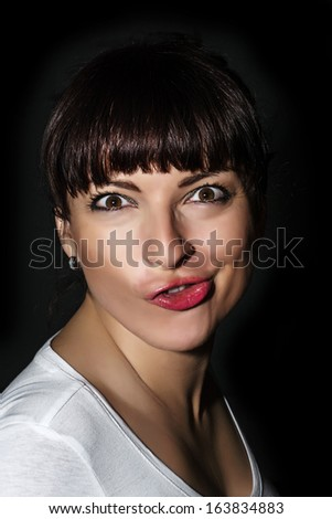 Young playful caucasian woman making a funny face. - stock photo