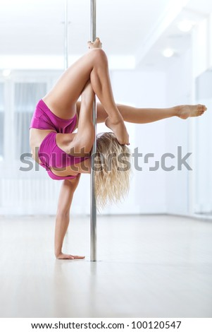 Young pole dance woman. Bright white colors. - stock photo