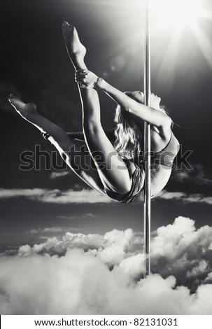 Young pole dance woman fantasy. - stock photo