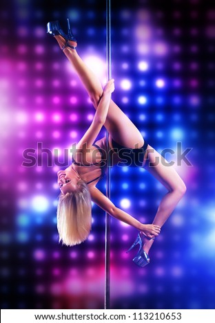 Young pole dance woman on lights background. - stock photo