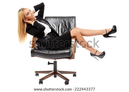 Young positive caucasian businesswoman sitting in her CEO chair, isolated on white  - stock photo