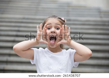 Young positive girl screams attracting attention for  all around - stock photo
