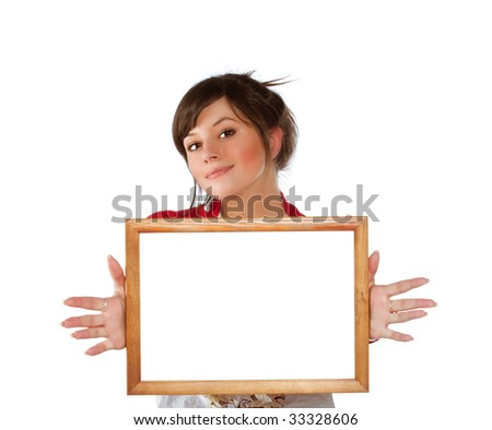 Young positive woman with empty wooden frame in hands - stock photo