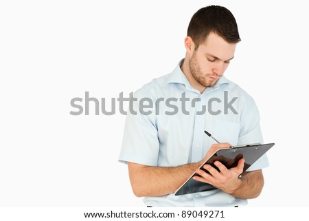 Young post employee taking notes against a white background - stock photo
