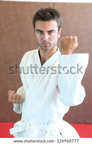 Young practicing judo - stock photo