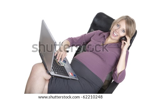 young pregnant business woman at work - stock photo