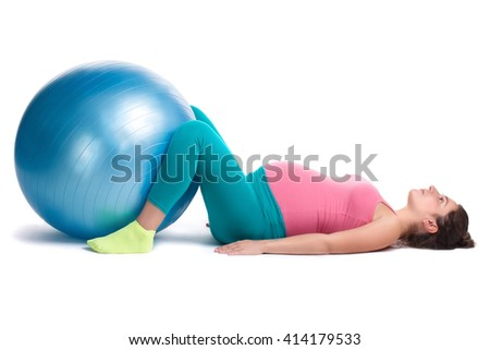 Young pregnant woman in bright colorful sportswear doing sport exercises with ball for fitness.  From pregnant with sport series. - stock photo
