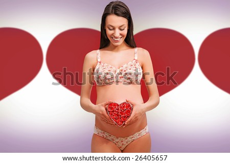 Young pregnant woman over vector background - stock photo