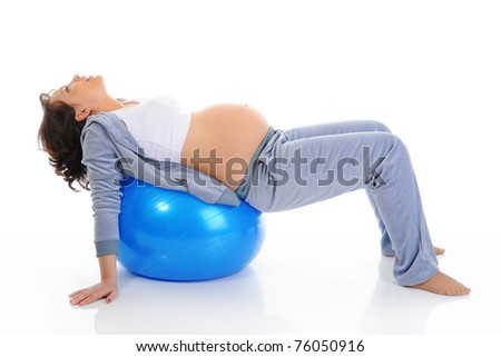 young pregnant woman sitting with exercise bal. Isolated on white background - stock photo