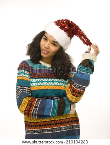 young pretty african american girl in red christmas hat isolated - stock photo