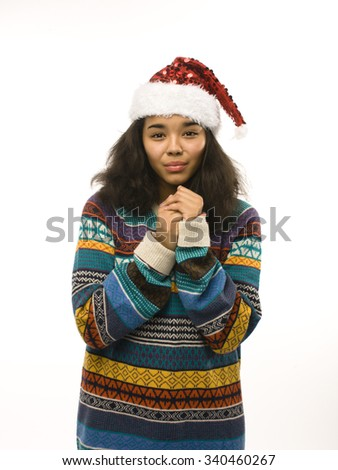 young pretty african american girl in red christmas hat isolated on white background emotional isolated - stock photo