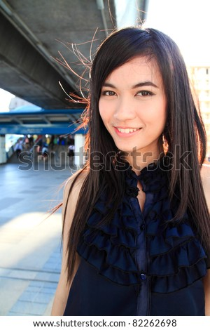 Young pretty asian woman smiling - stock photo