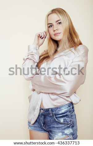 young pretty blond teenage girl close up portrait, lifestyle people concept - stock photo