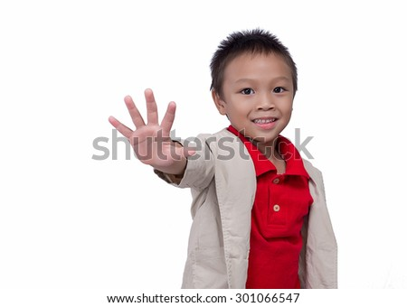Young pretty boy posing at studio as a fashion model white background,Asian little boy giving you thumbs up - stock photo