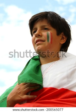 Young pretty boy with painted flag - stock photo