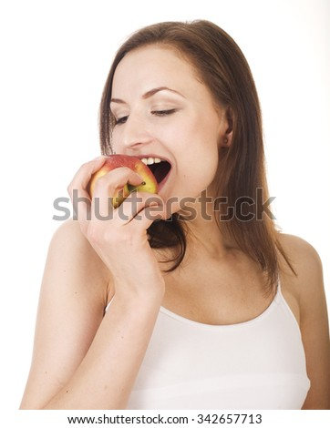 young pretty brunette girl eating red apple isolated on white background - stock photo