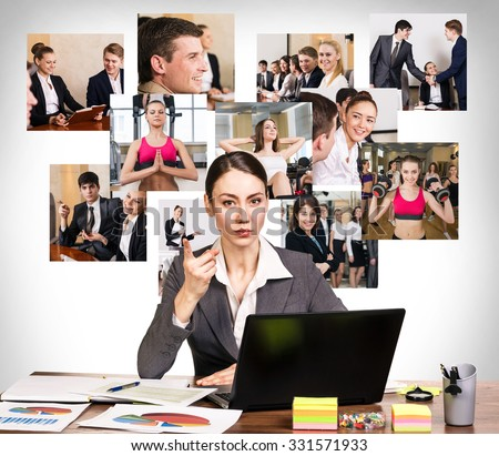 Young pretty business woman wags one's finger in the office and collage on the wall - stock photo