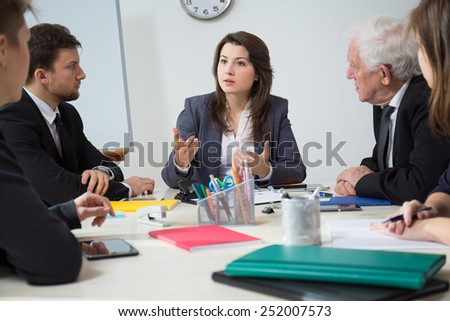 Young pretty businesswoman presenting her ideas  - stock photo