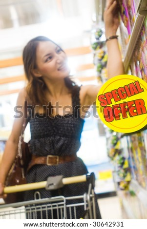 young pretty caucasian lady shopping for offers and bargains - stock photo