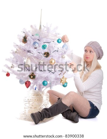 Young pretty christmas woman with christmas tree isolated on white background - stock photo