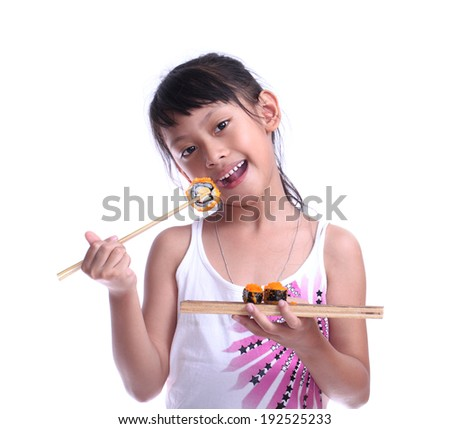 Young pretty girl eating sushi with sticks isolated on white background. - stock photo