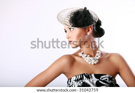 Young pretty girl's in a vintage black and white dress portrait - stock photo