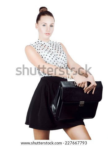Young pretty girl student with man's leather briefcase. Isolated. Copy space.  - stock photo