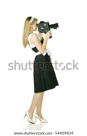 Young pretty Girl with film camera on white background - stock photo