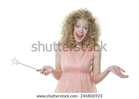 Young pretty girl with magic wand shouts - stock photo