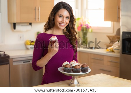 Young pretty housewife home chef baker amateur recipe cupcake dessert vegan low calorie - stock photo
