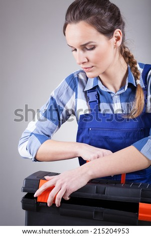 Young pretty independent repairwoman finishing her work  - stock photo
