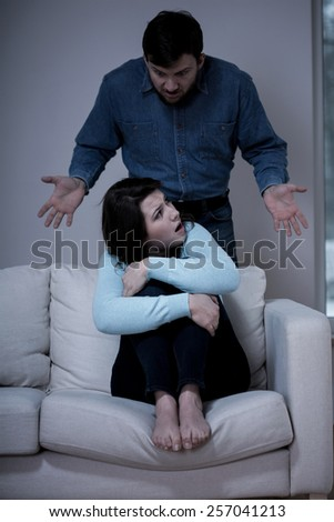 Young pretty outraged woman and her offensive man - stock photo