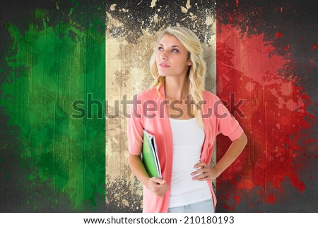 Young pretty student smiling against italy flag in grunge effect - stock photo