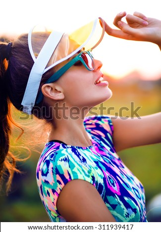 Young pretty teen girl with perfect slim fit body wearing stylish hipster outfit.sunny lifestyle fashion portrait of young stylish hipster woman walking on street,wearing cute trendy outfit.neon cap - stock photo