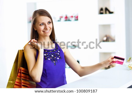 Young pretty woman doing shopping with credit card - stock photo