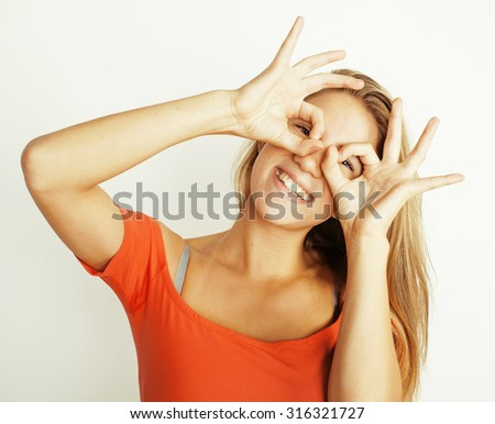young pretty woman fooling around on white isolated, smiling gesture - stock photo