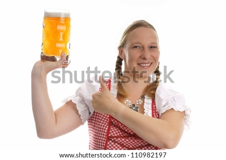 young pretty woman in a dirndl and Pint / munich beer festival - stock photo