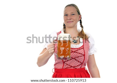 young pretty woman in dirndl with beer mug / munich beer festival - stock photo