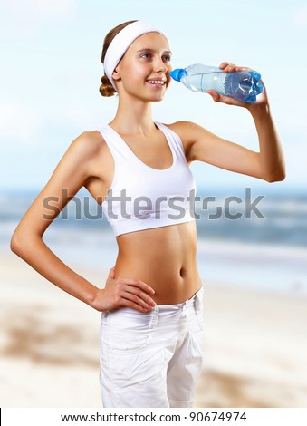 Young pretty woman in sport wear doing sport - stock photo