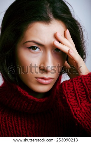 young pretty woman in sweater and scarf all over her face close up, sensual winter look - stock photo