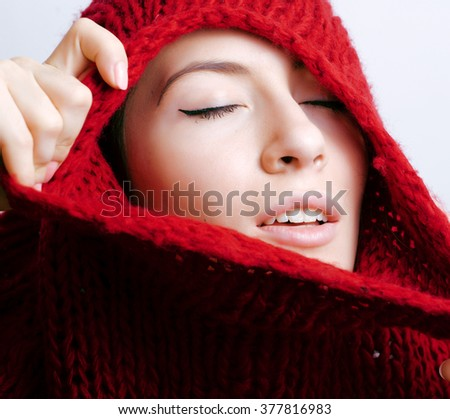 young pretty woman in sweater and scarf all over her face, winter cold close up coming, red lips makeup sensual - stock photo
