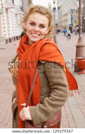 Young pretty woman in the street - stock photo