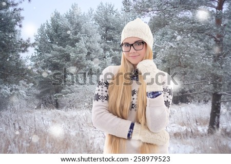 young pretty woman in warm clothes walking in winter park - stock photo