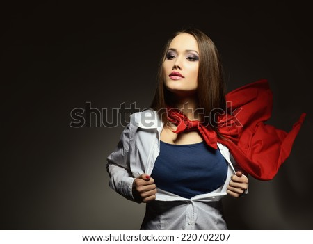 Young pretty woman opening her shirt like a superhero. Super girl, image toned. Beauty saves the world. Image toned. - stock photo