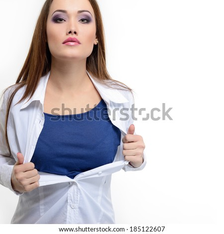 Young pretty woman opening her shirt like a superhero. Super girl over white.  - stock photo