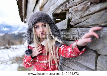 young pretty woman portrait outdoor in winter - stock photo