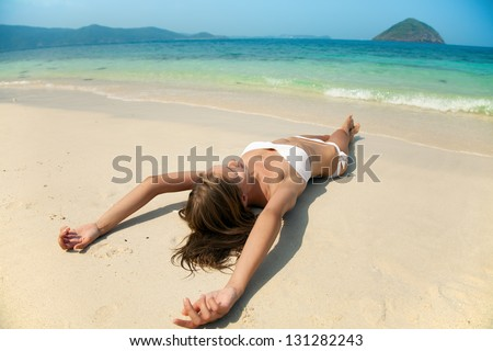 Young Pretty Woman Relax On Sand At Beach - stock photo